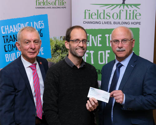 NIGTA President David  Garrett, right and NIGTA Chief Executive Robin Irvine, left are pictured handing over a cheque to David Hall, Fields of Life. Photograph: Columba O'Hare/ Newry.ie