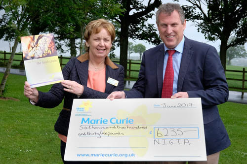 Keith Agnew, President, NIGTA is pictured presenting a cheque for £6235.00 to Sandra Spence, Marie Curie.